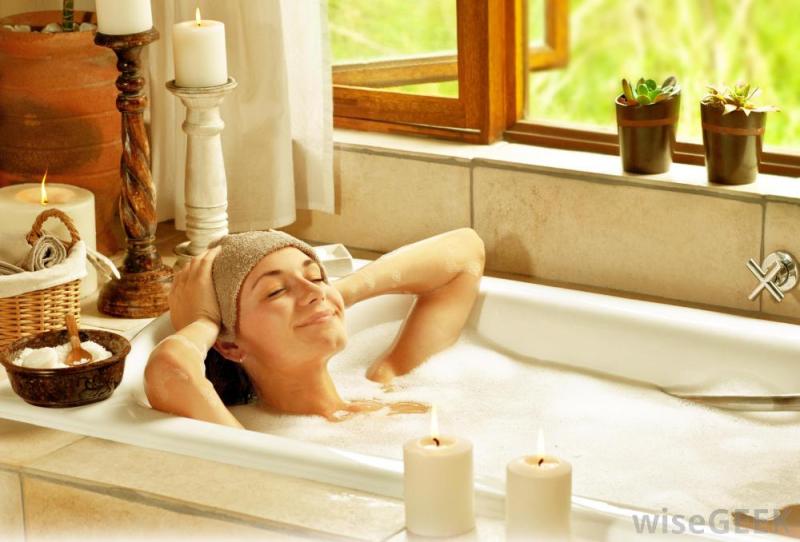 Woman-in-warm-bath-near-window